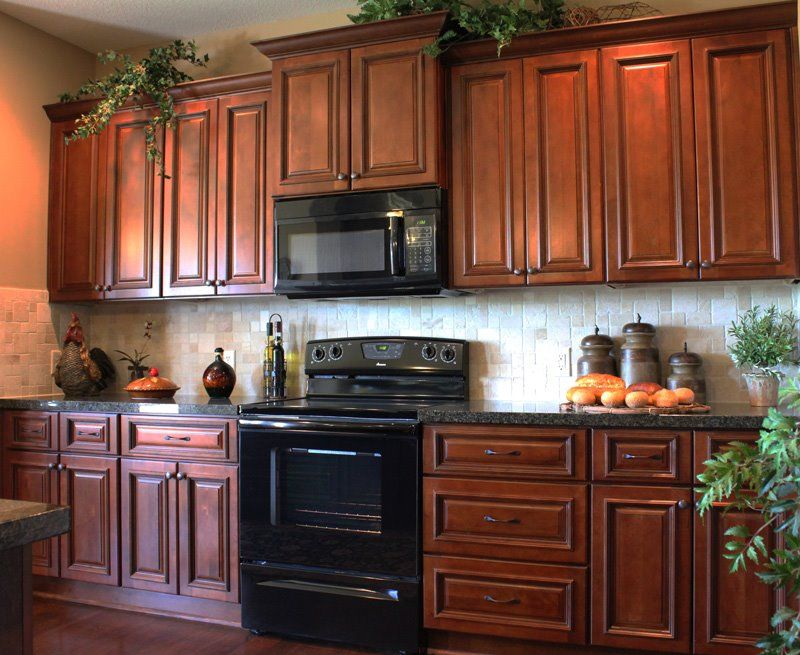 Galley kitchen with staggered heights in a rich cherry ... on Kitchen Tile Backsplash Ideas With Maple Cabinets  id=94620