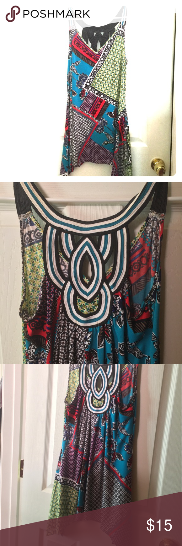 Colorful Tank or Tunic Patterned asymmetrical long tank top/tunic. Great with jeans or leggings. Beautifully designed back. In excellent condition. Medium size. No trades, offers accepted through button. Thanks for looking! Candie's Tops Tunics