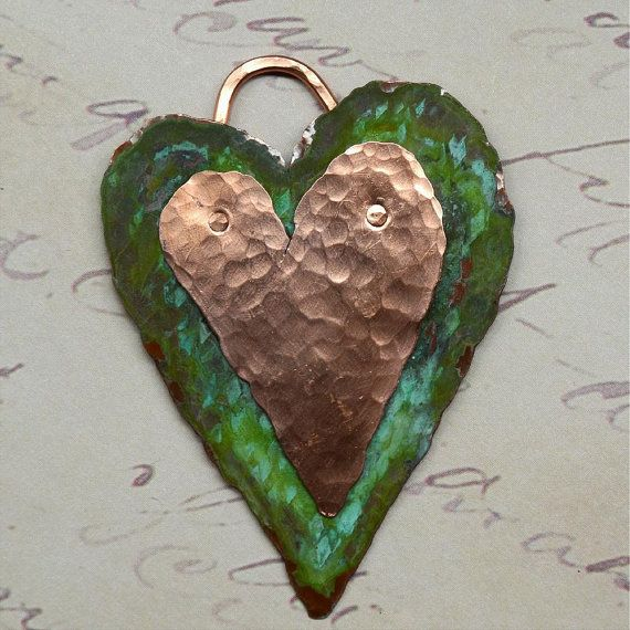 Hand Forged Copper Heart Pendant Component by SunStones on Etsy, $19.00  This heart shaped component is made from a sheet of copper which I designed, hand cut with a jeweler's saw, hammered, antiqued and tumbled. The bottom layer I used Swellegant patina rather than the salt/vinegar/ammonia solution I normally use - it creates a totally different effect. I riveted the pieces together, including the wire bail. Ready for your embellishment or to use as is!