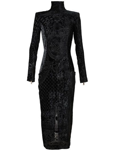 35c4c8e4011 Midnight black devore velvet dress from Balmain. Stand-up neckline.  Structured shoulder pads. Long sleeves with exposed zip cuffs. Exposed zip  down back.