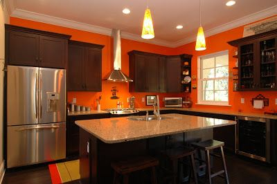 Bright orange kitchen walls with dark stained cabinets for Dark orange kitchen