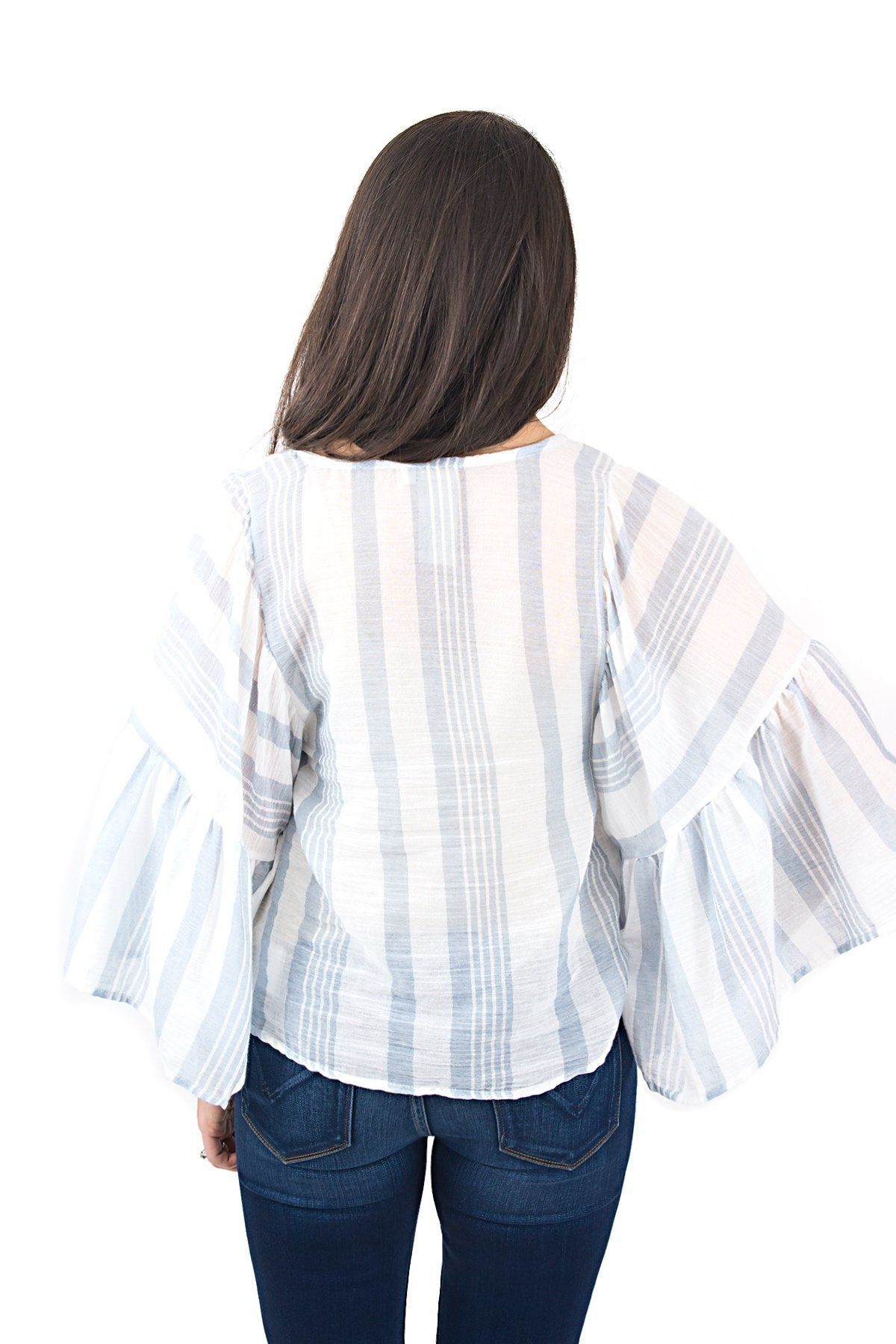 f0b86ffade This breezy striped top features oversized statement sleeves... so. much.  fun