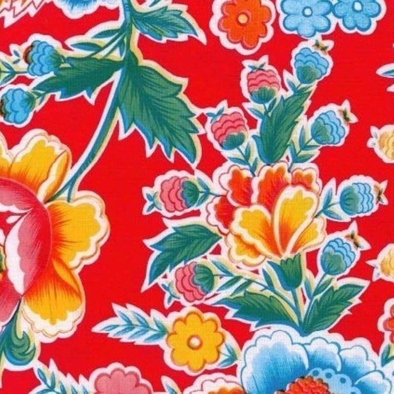 Mexicaans tafelzeil Fantasia Rood - Mexicaans tafelzeil fantasia rood met fleurige bloemen zoals bijvoorbeeld klaprozen. Het tafelzeil van Kitsch kitchen is oerdegelijk en is dus ideaal geschikt om mee te knutselen. Maar natuurlijk ook perfect als tafelkleed op de keukentafel! Te bestellen vanaf 50 centimeter.