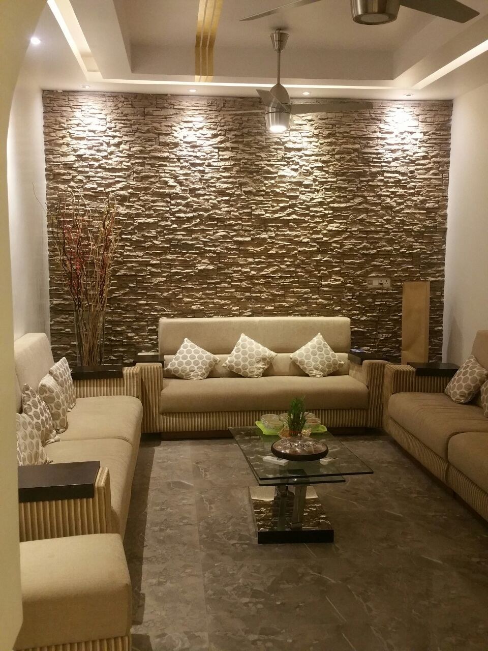 Lights Pointing Down At Rock Wall Living Room Design Modern