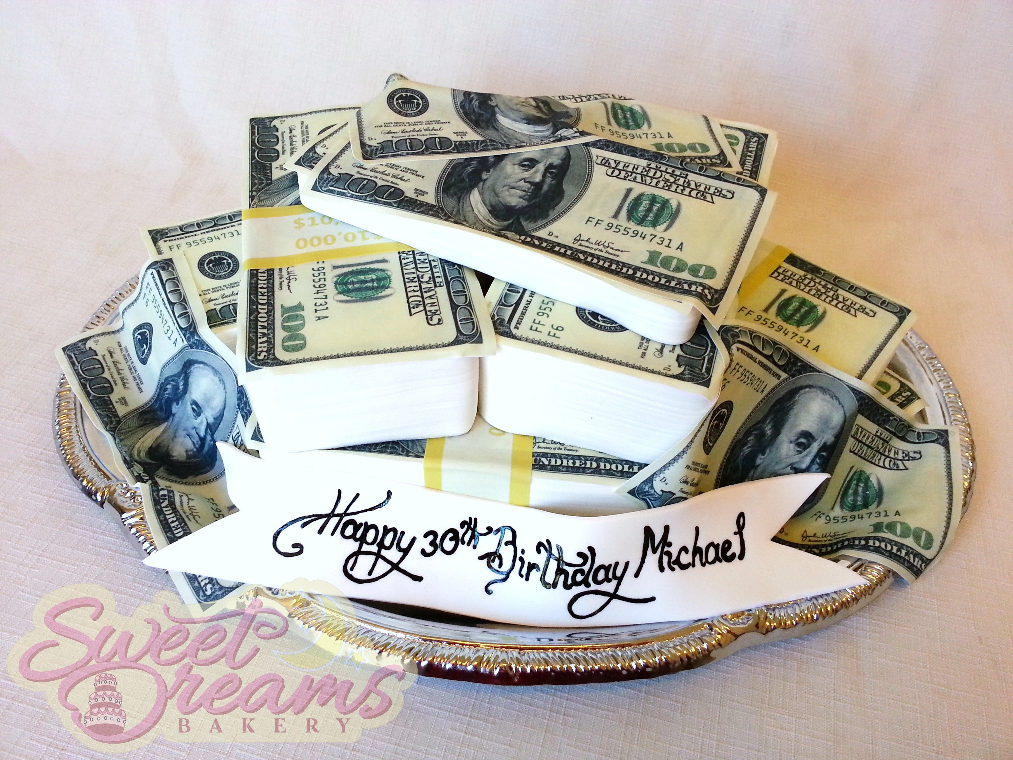 Platter of money cake with marshmallow fondant and edible sugar sheet decorations from sweet - Money cake decorations ...
