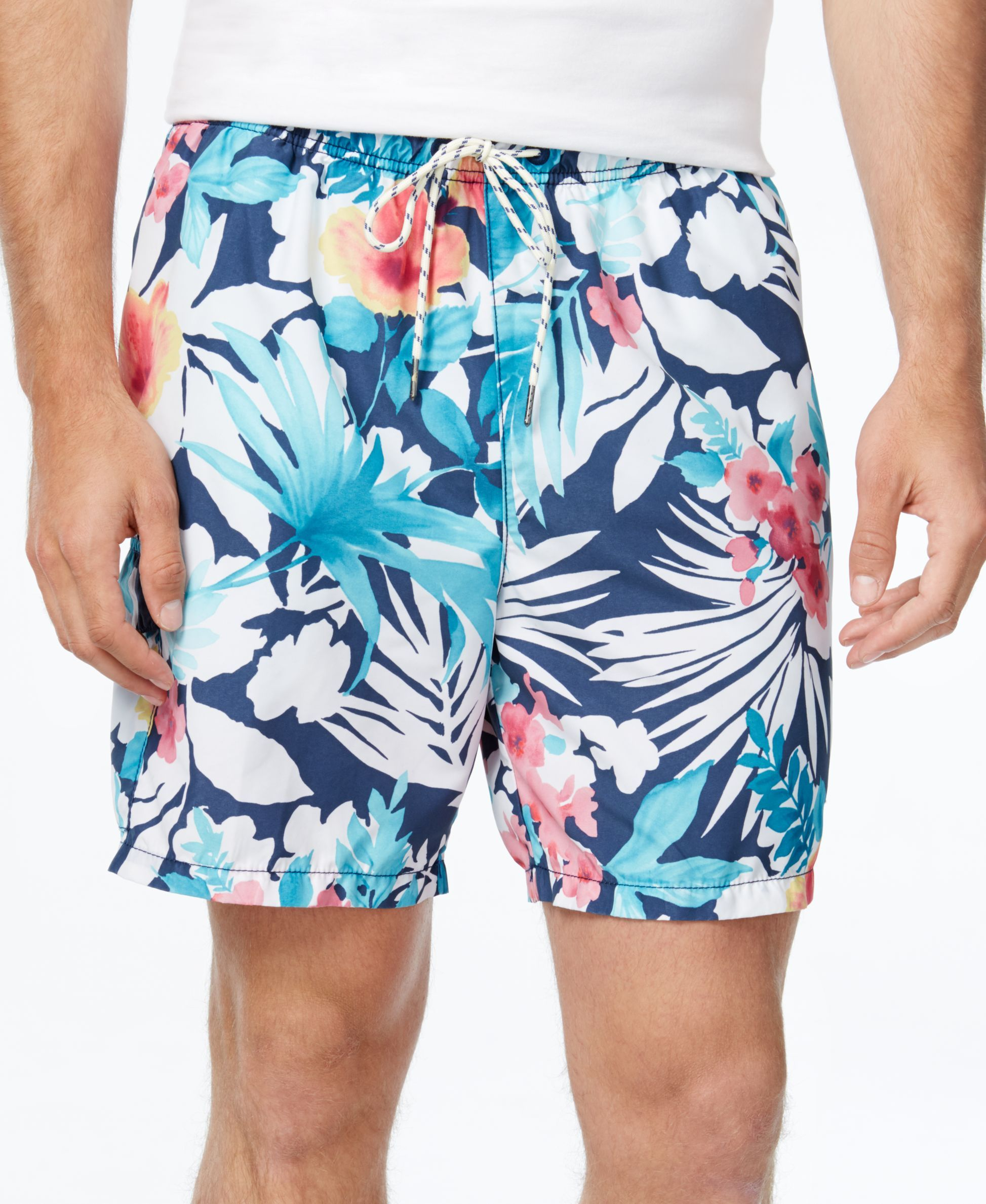 Bring your beach-ready look to life with the comfortable fit and vivid, floral print of these Naples Bastille swim shorts from Tommy Bahama. | Shell and lining: polyester | Machine washable | Imported
