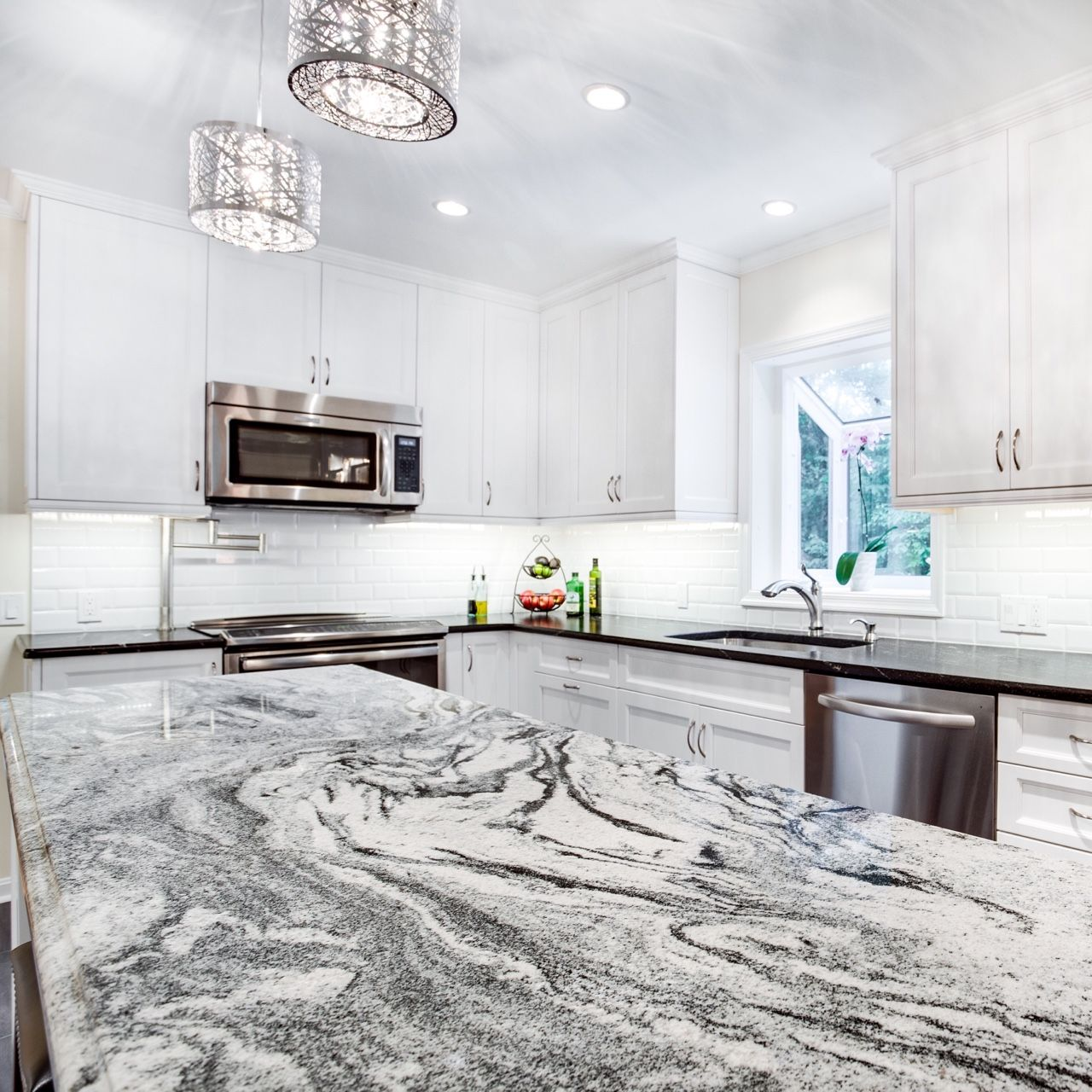 This Silver Cloud granite kitchen island countertop makes quite an ...