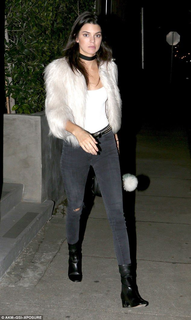 75a8f8f82f1c86 Kendall Jenner was spotted heading out of a pal's house in Los Angeles on  Wednesday in a white fur coat and ripped skinnies