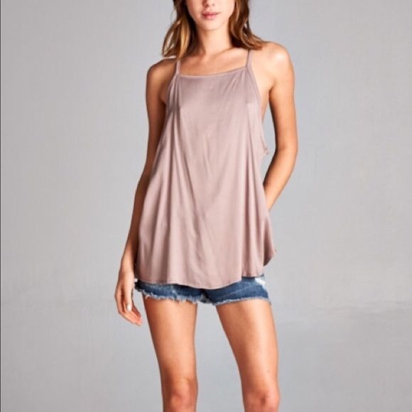 LAST ONE IN MEDIUM Mocha Boho Tank Loose fit Boho tank. Mocha color. This listing is for MEDIUM. There are another listing for S and L. 97% rayon, 3%spandex April Spirit Tops Tank Tops