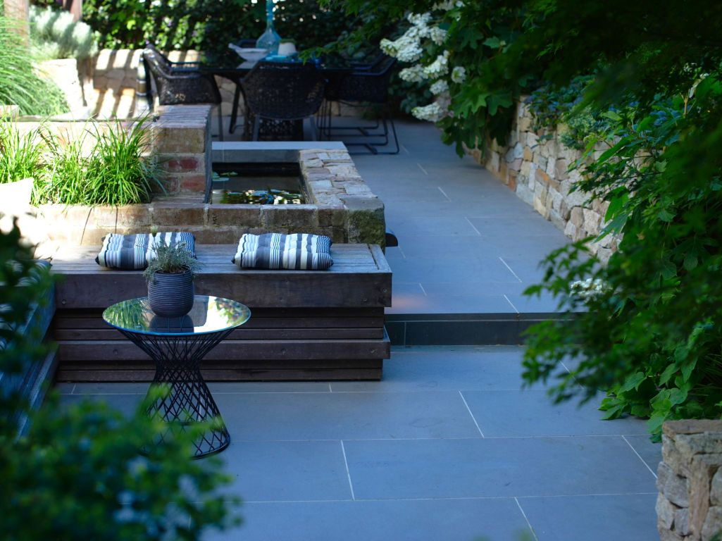 eco outdoor bluestone paving and alpine dry stone walling in