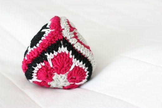 Sort of pink: A crochet toy.