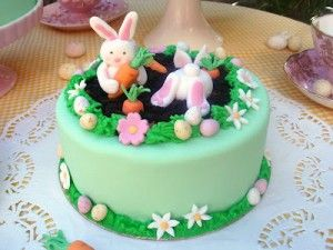 a cake for a gardener with bunny rabbits stealing carrots by Butter