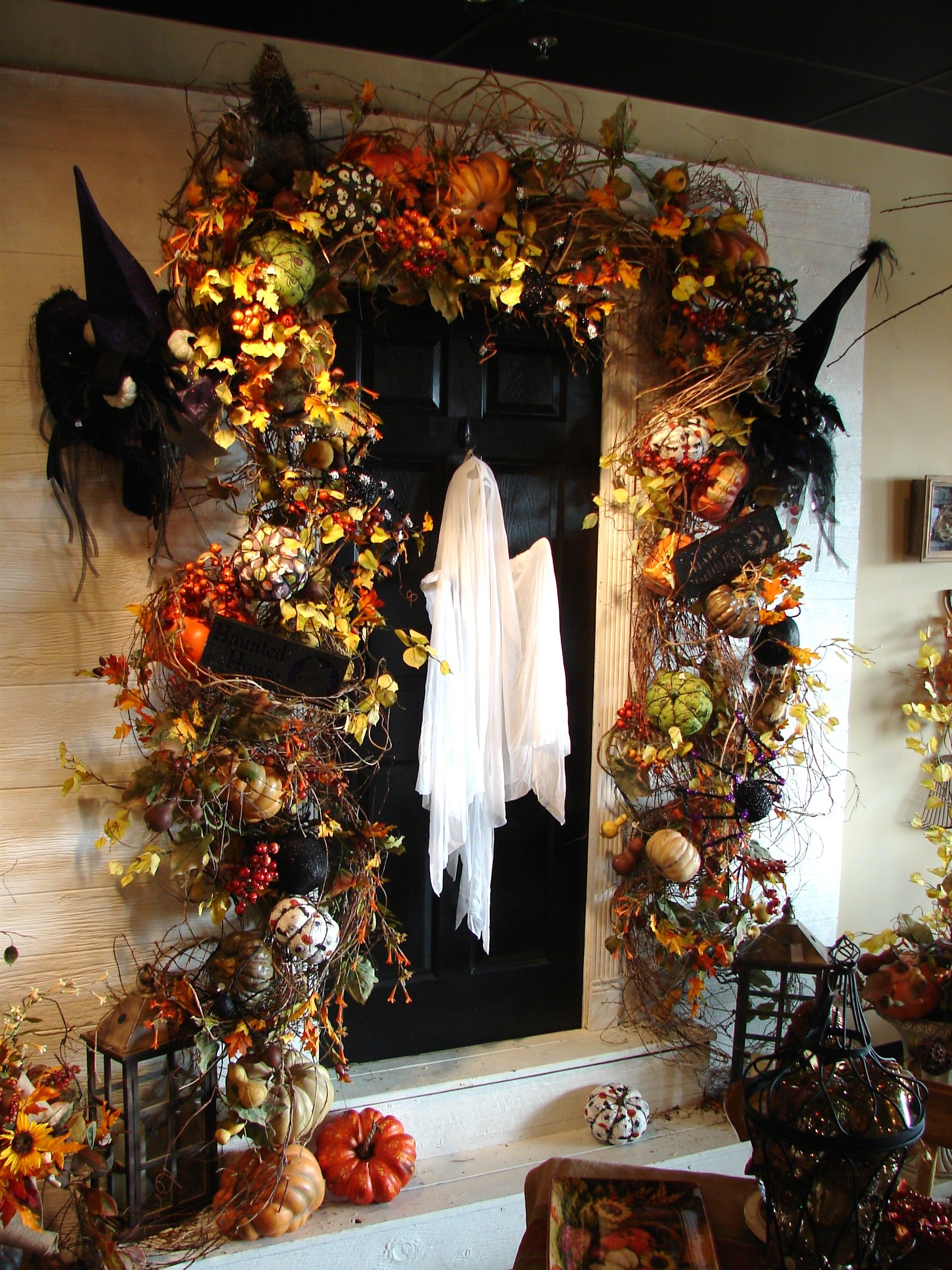 Honey suckle and Halloween decor used around your front door - Front Door Halloween Decorations