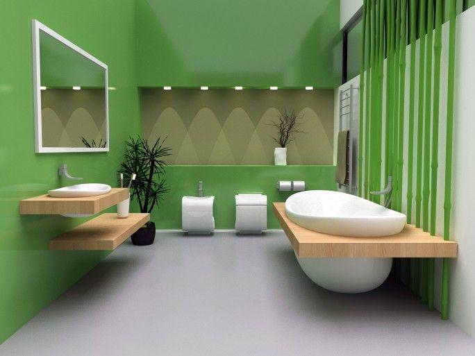 Zeitgenössische grüne Badezimmer mit weißen Wanne, Toilette und ...
