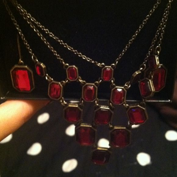 Necklace & earring set Red gems on gold chain matching earring & necklace set! Worn once! Still in box! Excellent condition Jewelry Necklaces
