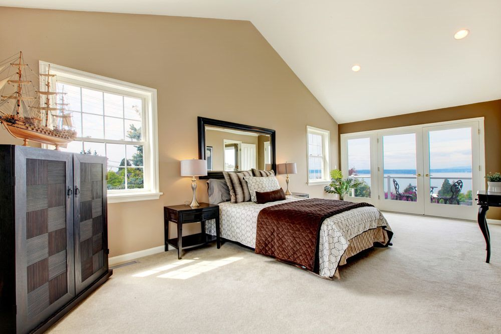 Attic bedroom with white carpet light brown