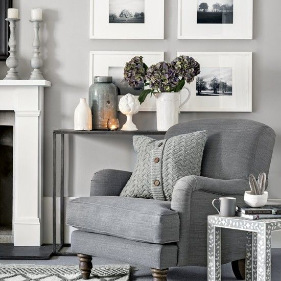 Warm light grey living room with cosy armchair and knitted for Warm grey living room ideas