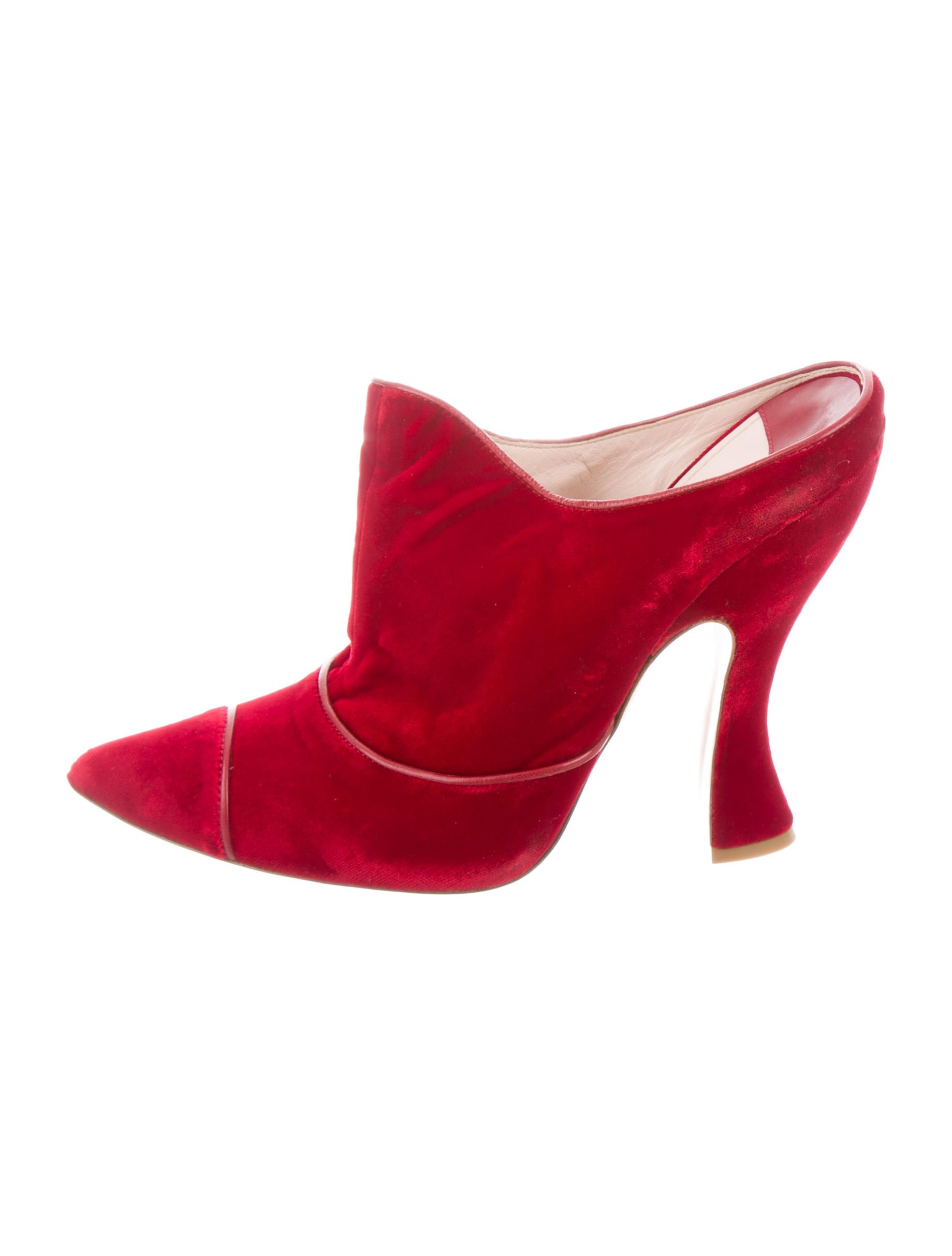 Red velvet Miu Miu pointed-toe mules with leather trim and sculpted heels.