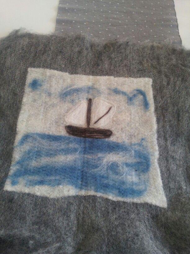 Sitteunderlag laget av ull