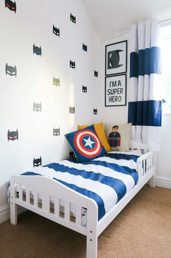 Super Hero Wall Decals Pillows And Some Posters Add A Cool Touch To This Room