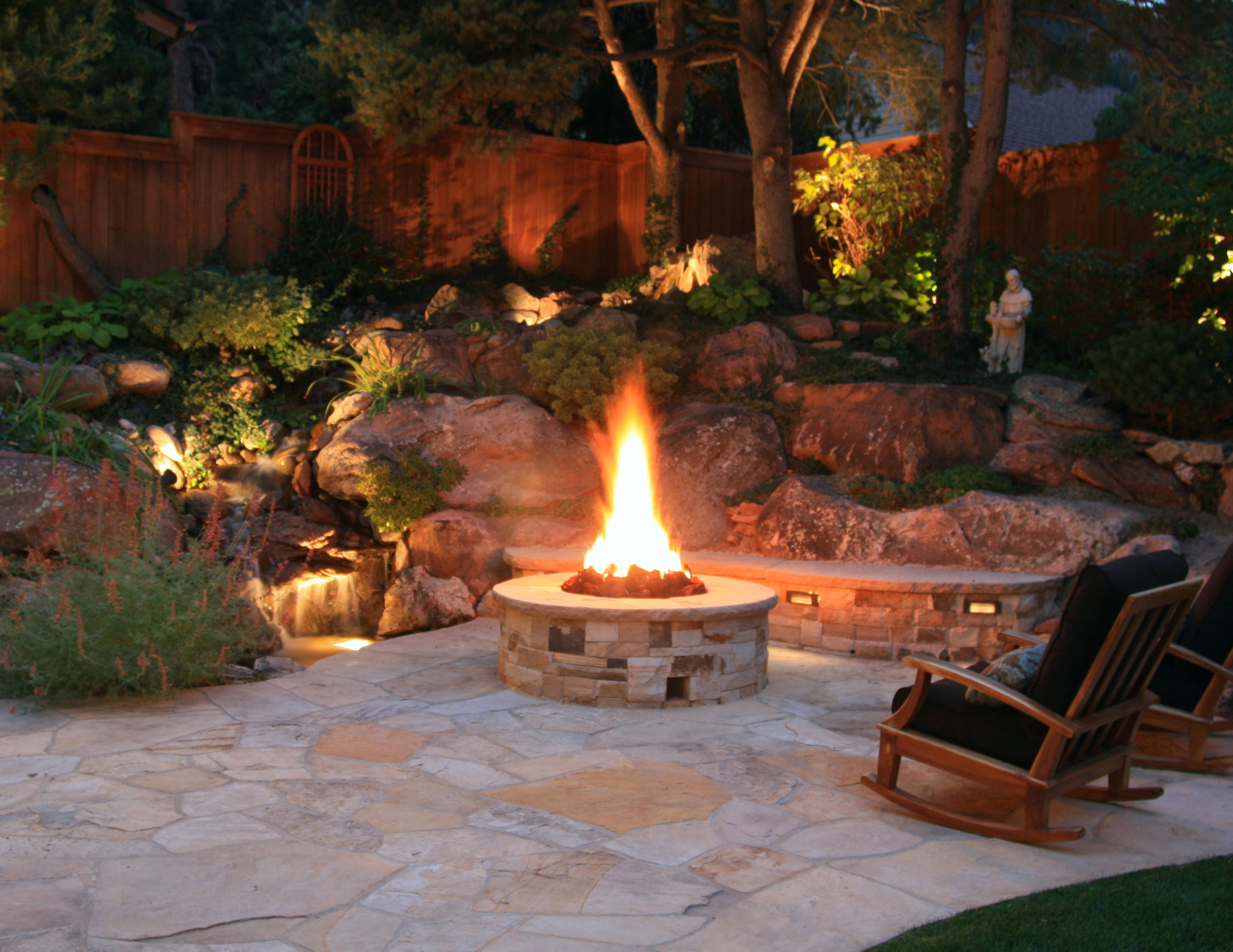 the stone patio and fire pit are complimented by the on backyard fire pit landscaping id=45466