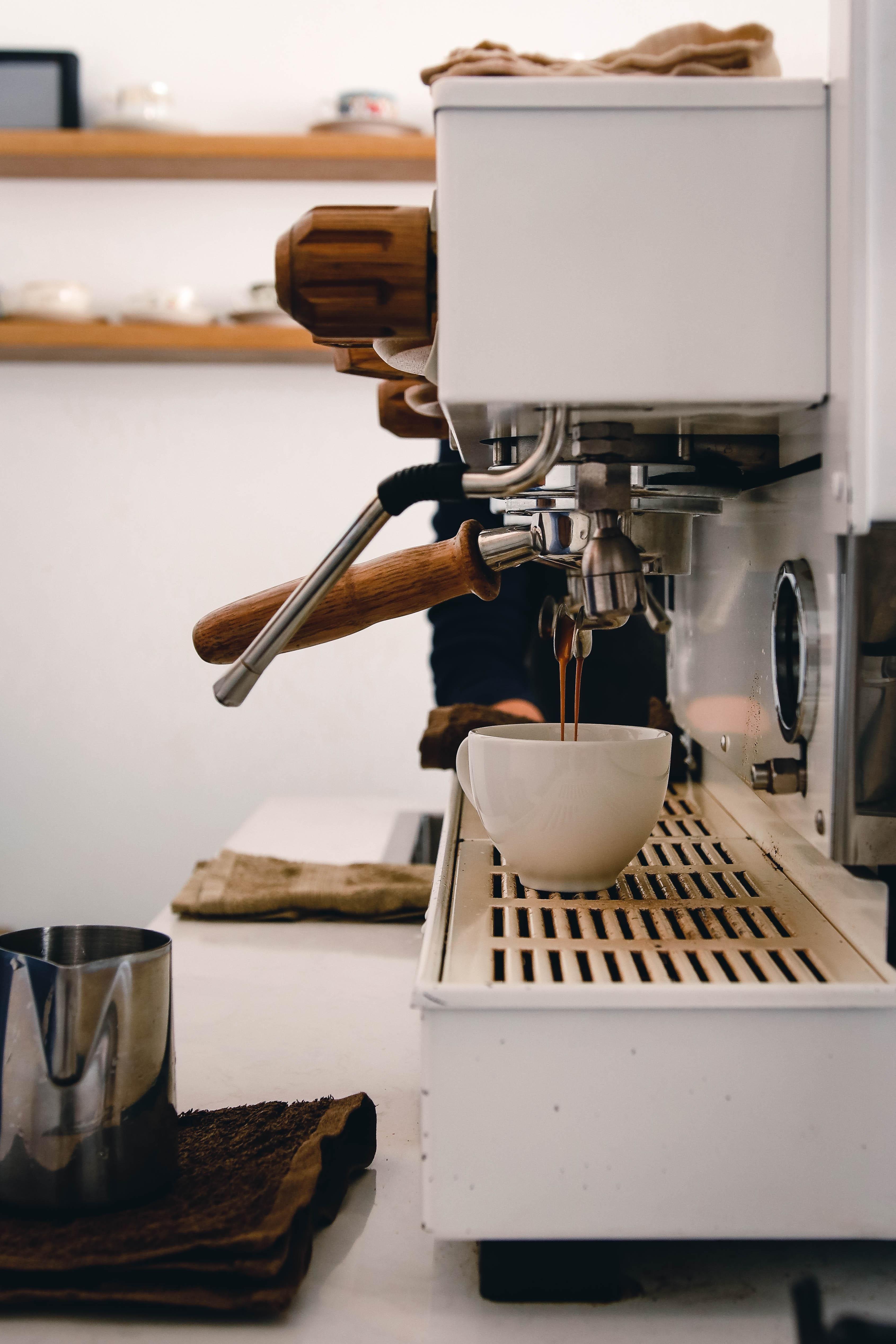 ITAP of la marzocco pouring espresso photo background