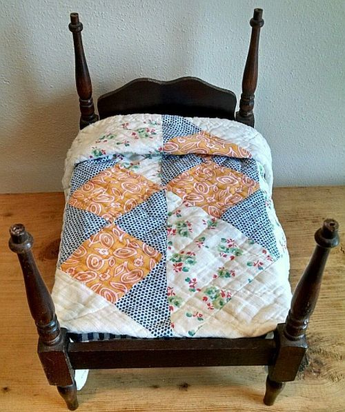 Vintage Wooden 4 Post Doll Bed with a 1930s Quilt.