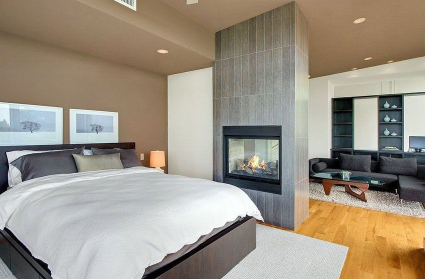 Master Bedroom Floor To Ceiling Stone Fireplace Hardwood Floor