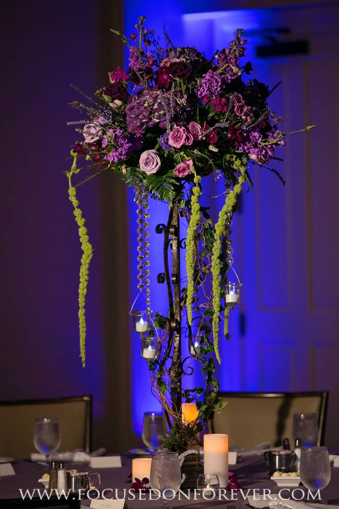 Beautiful Floral design by Sarah at Giordano's Floral Creations in Ft. Pierce, FL.  #focusedonforever #weddingphotography #centerpieces #weddingcenterpieces #ido #weddingdecor