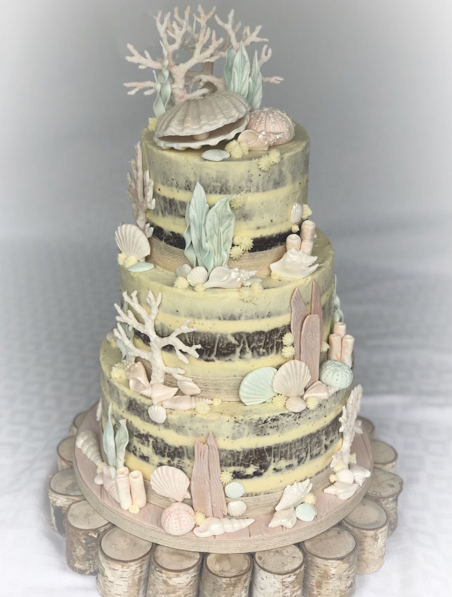 Beach theme wedding cake with sugarpaste coral, seaweed, driftwood ...