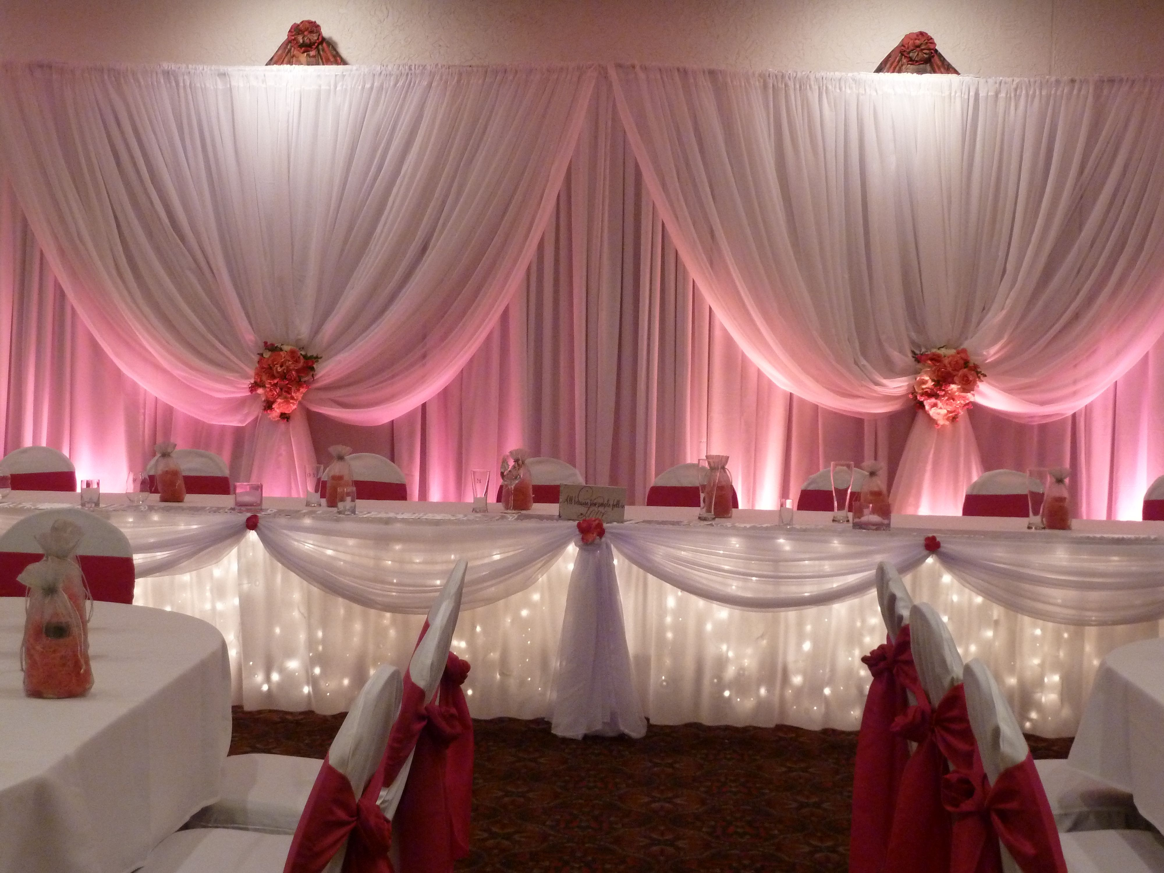 Beautiful Fabric head table backdrop with pink uplighting ...