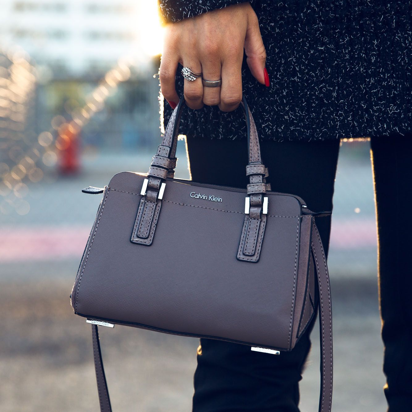 2c18050c822 A close-up of the Sophie micro saffiano leather duffle bag from Calvin Klein  Jeans, as styled by blogger @jannideler.