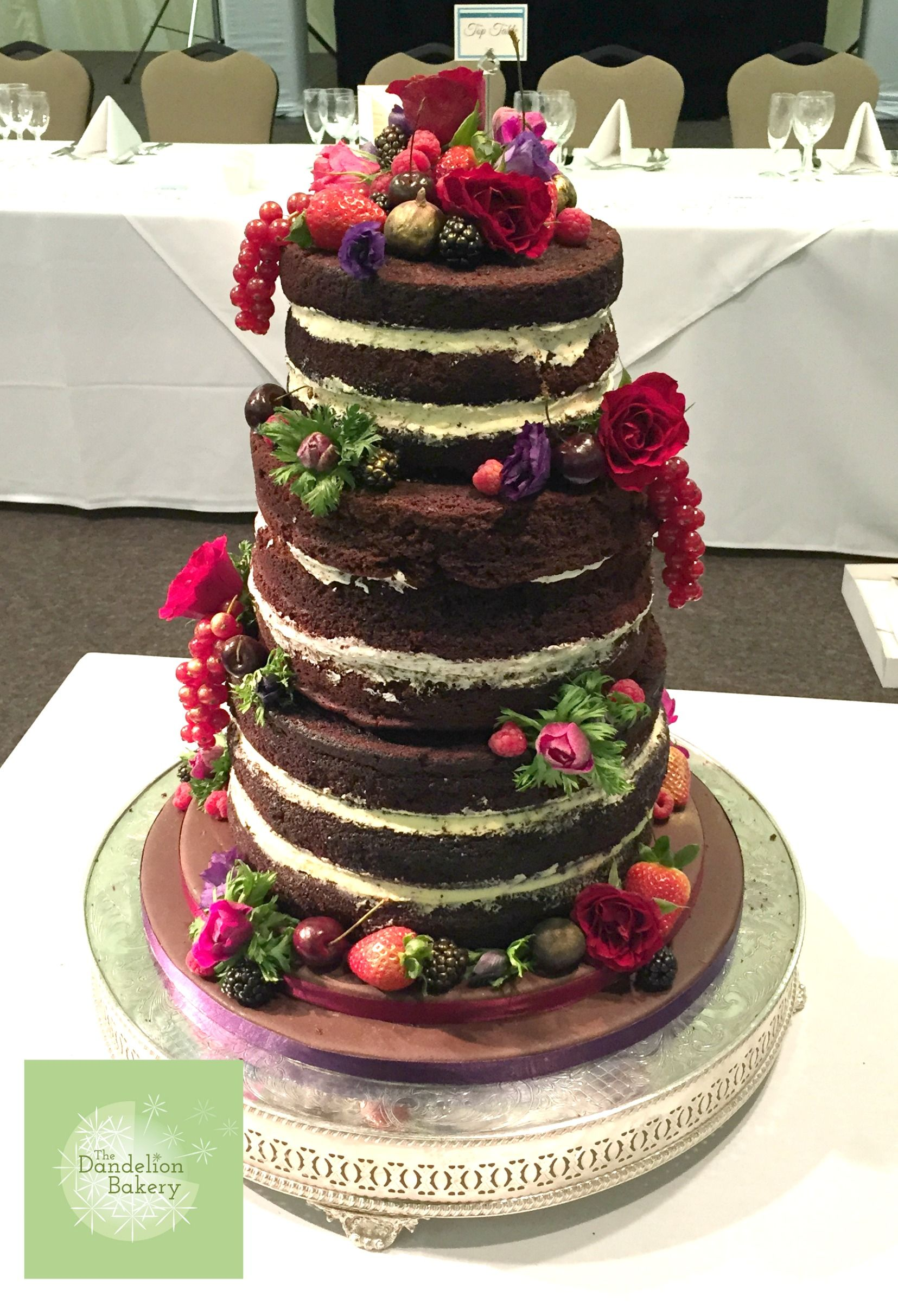 A Delicious Chocolate And Red Velvet Naked Wedding Cake Filled With White Ganache Cream