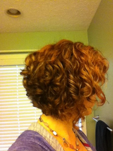 curly stacked bob. red