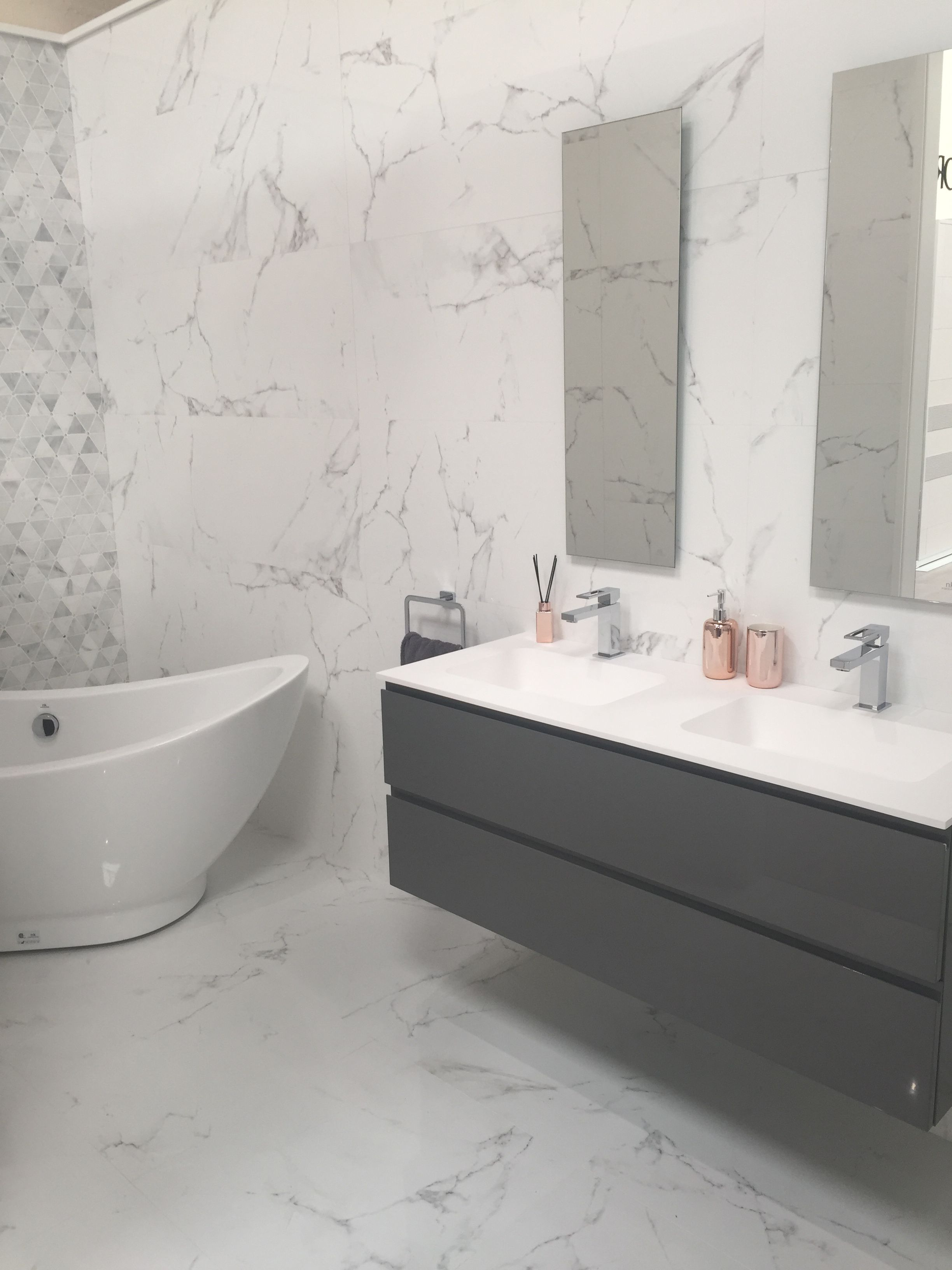 Our Favourite Bathroom Showroom Display Bright White Marble Wall