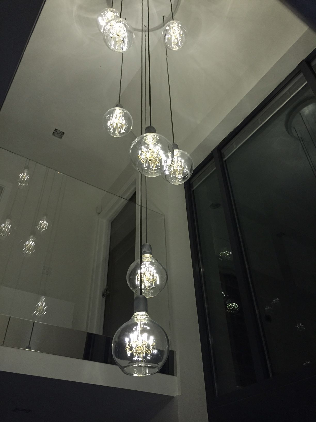 Cluster of 8 king edisons project for zing leisure httpwww mini chandelier inside glass bulb makes for one unusual pendant lamp arubaitofo Images