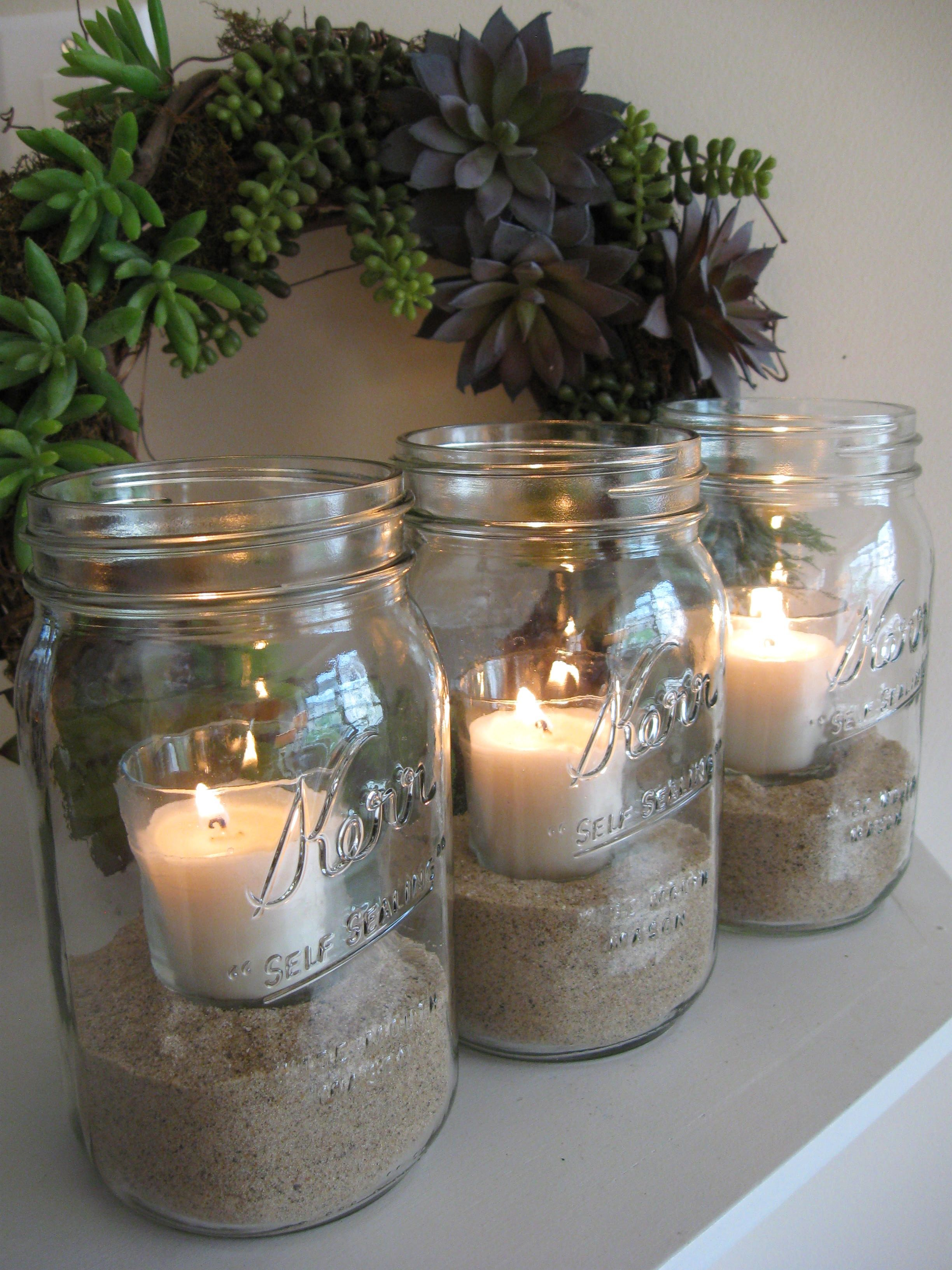 Glass votive candles set into clean, dry sand (Lowe's or