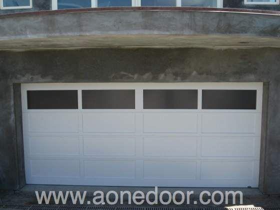 Roll Up Garage Door With Glass By A 1 Overhead Door Company In Santa Cruz Http Www Aonedoor Co Garage Door Installation Door Installation Garage Door Styles