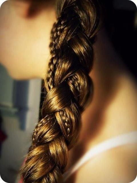 Separate hair into three sections like you would any simple braid. BUT before you start, put some slim braid in some or all the sections first!