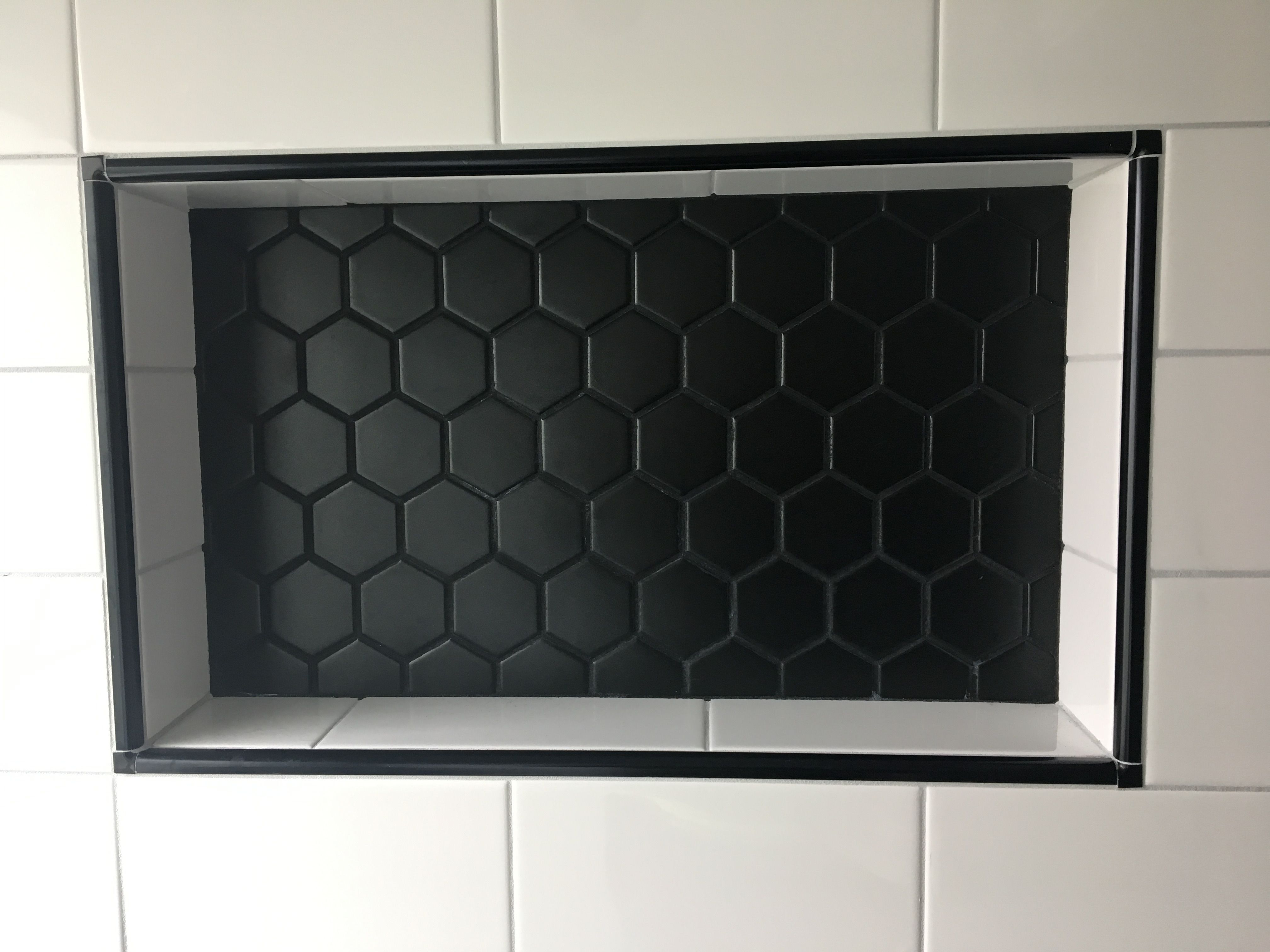 New Shower Niche With 2 Black Matte Hex Tiles And 4 X8 White Subway Tiles Edged With Black Schluter Trim Shower Niche Shower Tile Designs Schluter Tile Edge