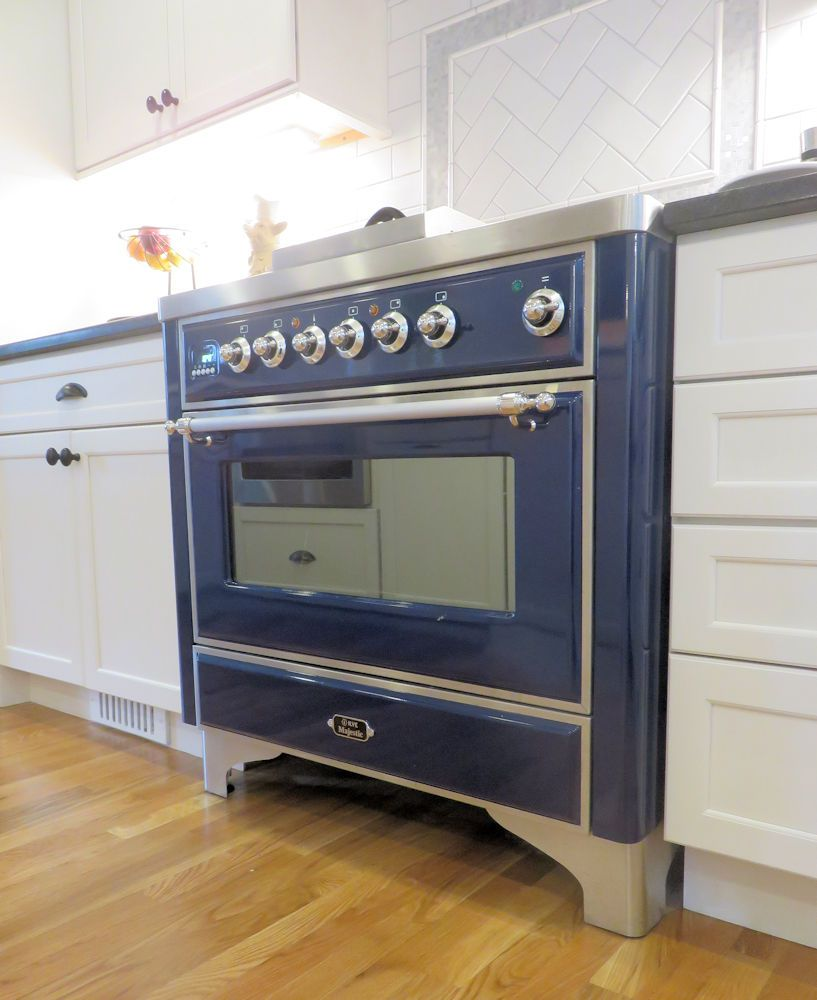 Budget Friendly Cabinets Transform This Massachusetts Ranch House Tan Kitchen Cabinets Tan Kitchen Kitchen Inspirations