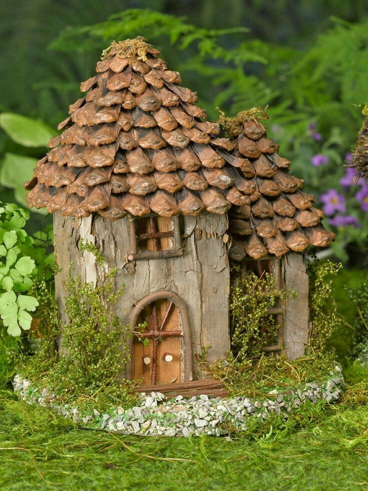 Faerie house with pine cone roof