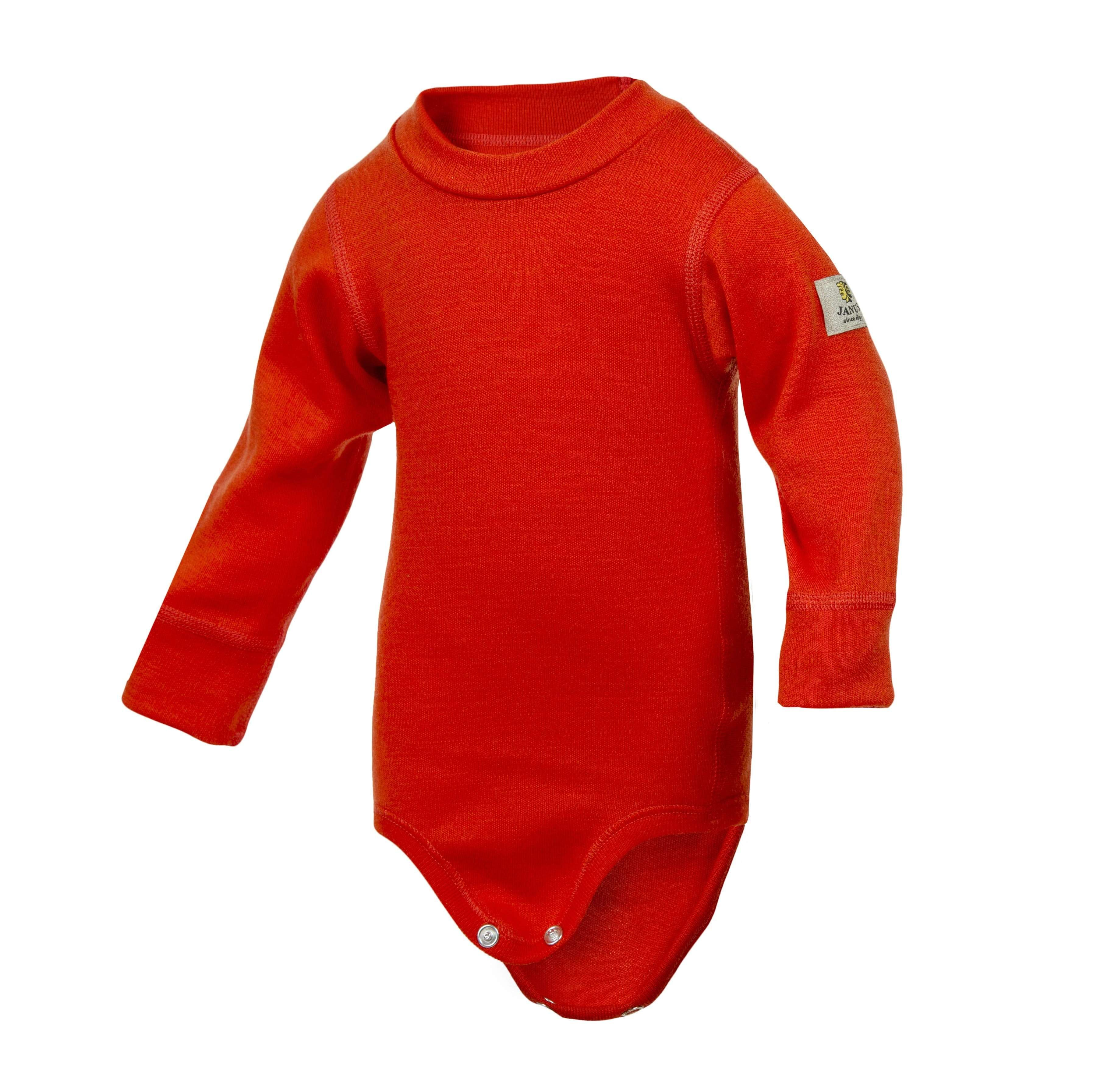 Janus Babywool body of thick, soft interlock knitted 100% merino wool. Flexible neck and snaps at the bottom for easy changing. Composition: 100% merino wool. Weight: 215 g / m2. Oeko-Tex approved. We recommend gentle washing and line drying your woolies for longest life.