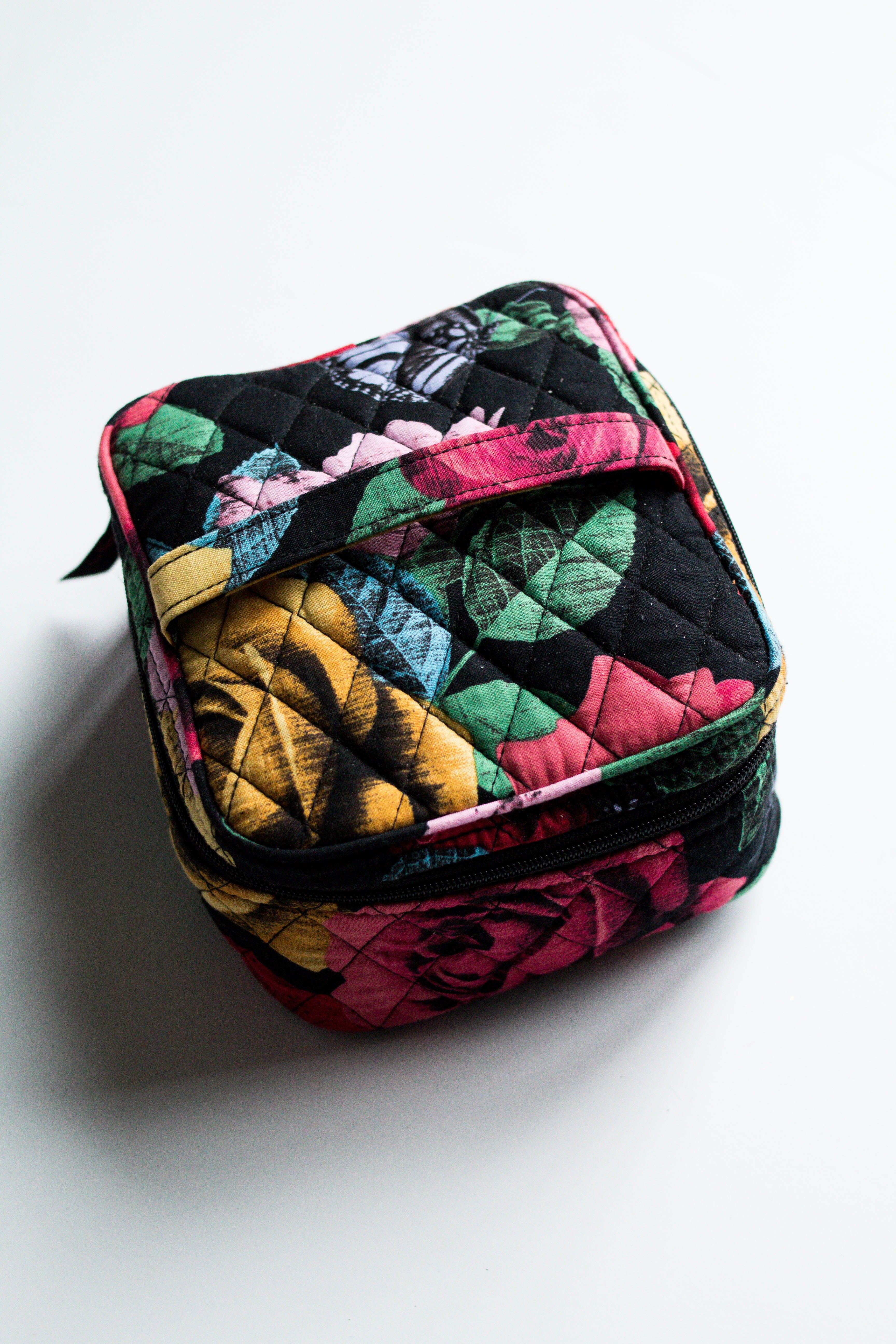 3858b4263172 ... up the necessities for your toiletry bag plus the best holiday gifts to  get for the travel lover on your Christmas list.    vera bradley makeup  bag