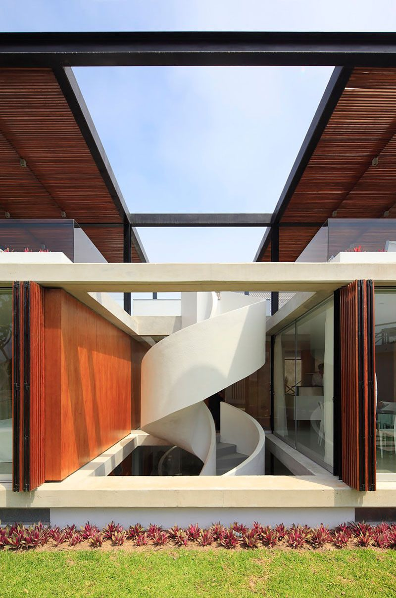 The spiral stairs in this home lead to an amazing rooftop deck