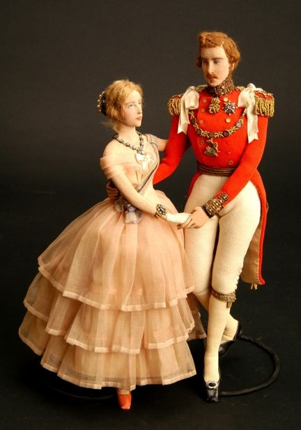 Could not verify -link is questionable- but these dolls look very much like a young Queen Victoria and Prince Albert.