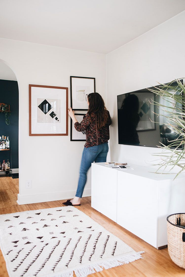 The easiest way to decorate around a big tv: a gallery wall! Learn how to curate a beautiful gallery wall to balance a large television using the Gallery Wall Designer and ArtView™️ feature of the @artdotcom app   enter the giveaway! #ad #LoveYourWall Learn more on jojotastic.com #gallerywall