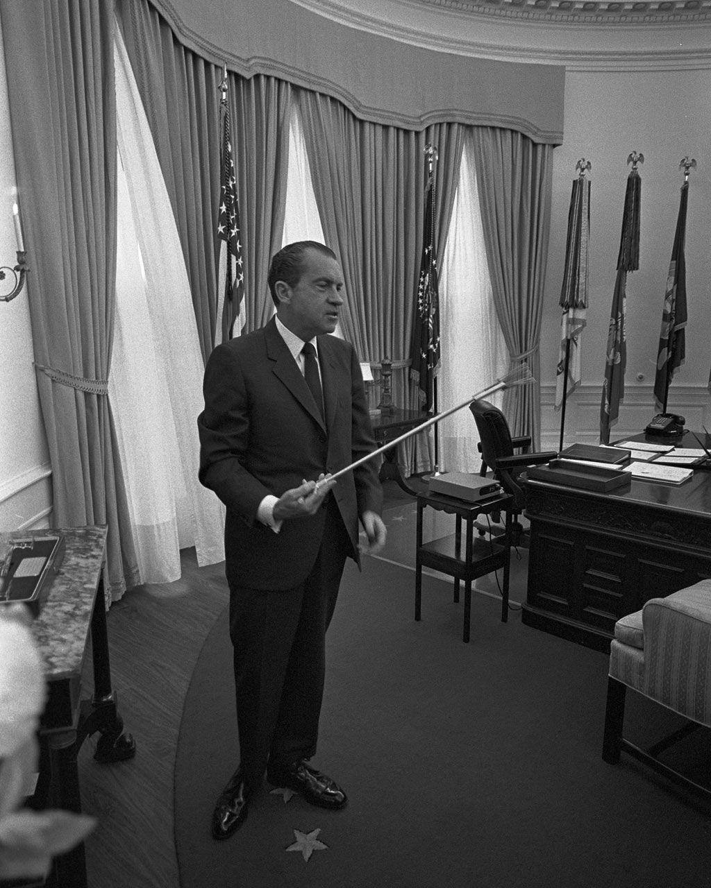 nixon office. President Nixon Standing In The Oval Office Holding Set Of Tongs Used By Astronauts During