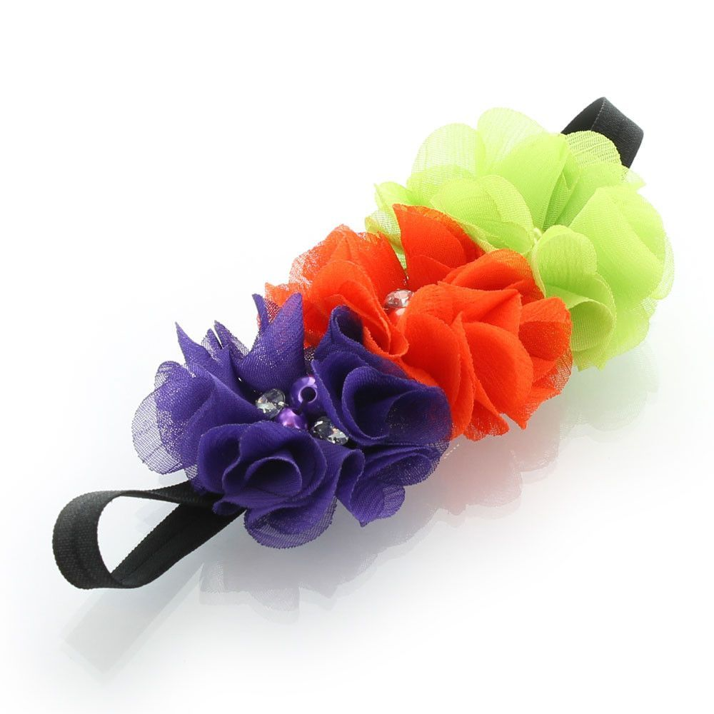 """Purple, orange, green, black - Halloween  Stretchy elastic headbands with three 2.25"""" fabric chiffon flowers attached.  The flower is attached to an elastic headband sized to fit newborns through around age 8mos.  We chose a narrow 3/8"""" width fold over elastic band for our infant size as we love how they are more petite for the little ones!  Darling as a photo prop hair accessory!  Age: newborn through 8mos. (13.5"""" - 15.5"""" head circumference)"""