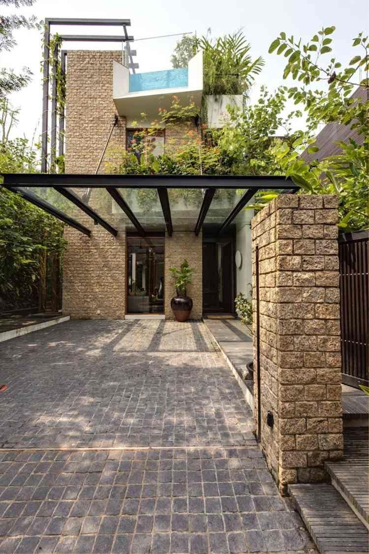 Hintergarten mit Pflastern, Mauern und Glas-Überdachung definieren ...